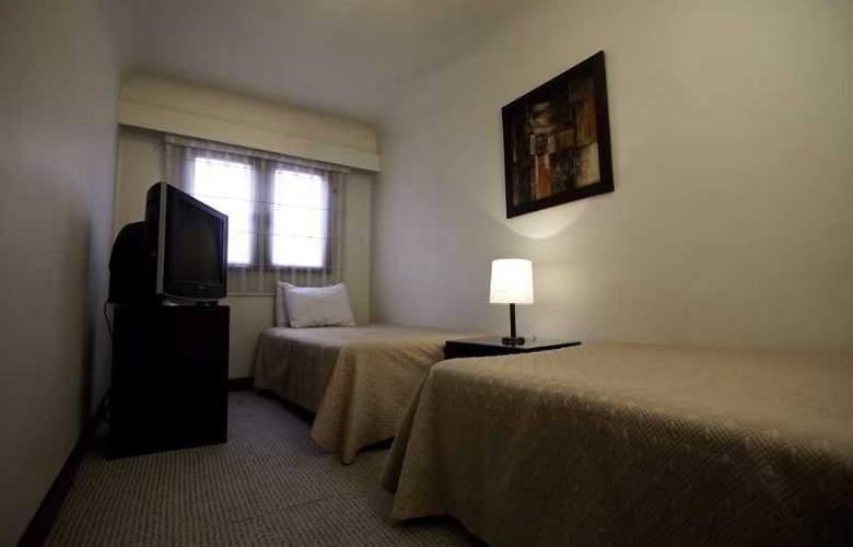 Travelers Apartamentos y Suites CondominioPlenitud - Room - 15