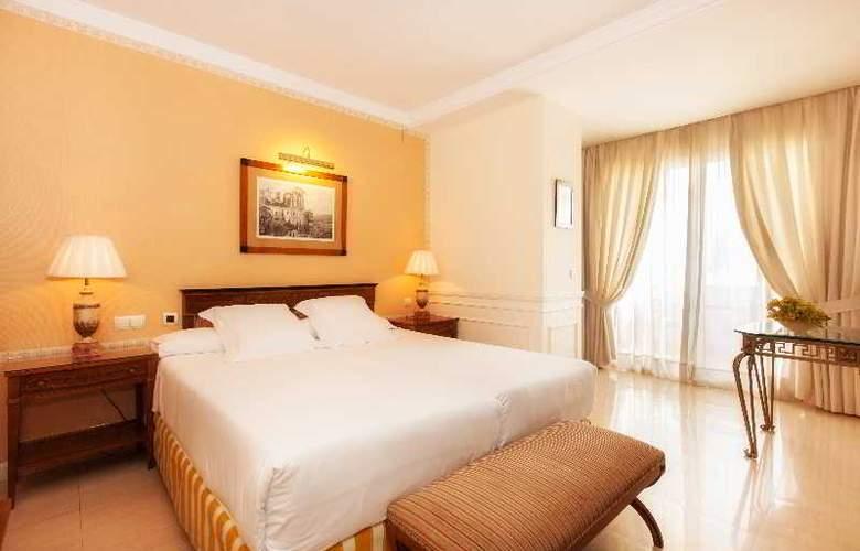 Apartamentos Guadalpin Suites - Room - 5