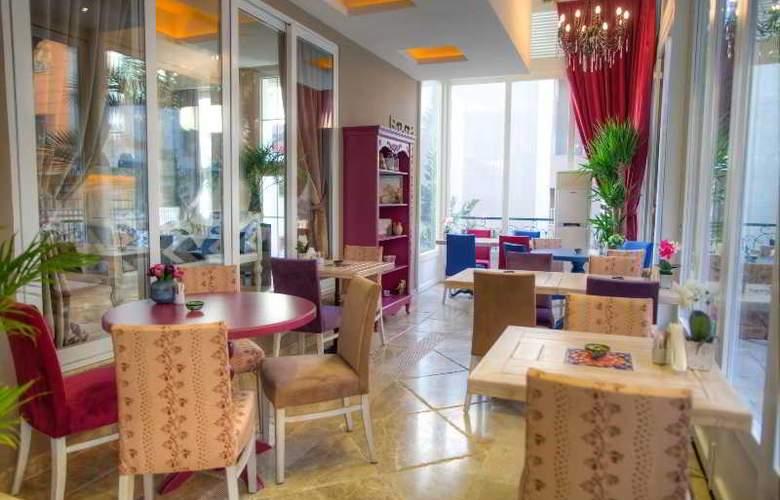 Elegance Asia Hotel - Restaurant - 3