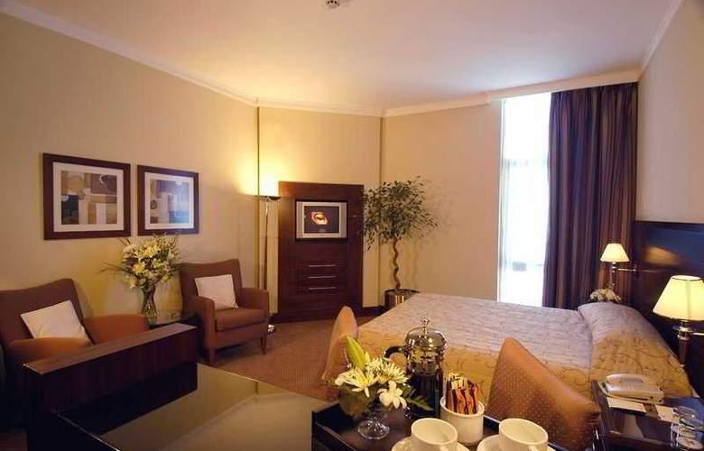 Rimal Rotana Suites - Room - 1