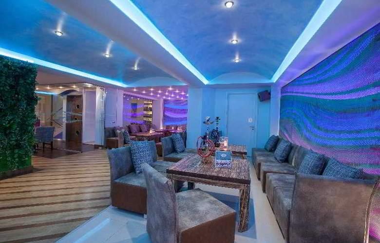 Palmera Beach Hotel and Spa - Bar - 6