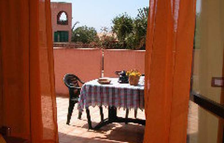 Casa Vacanze Perla Rosa - Room - 2