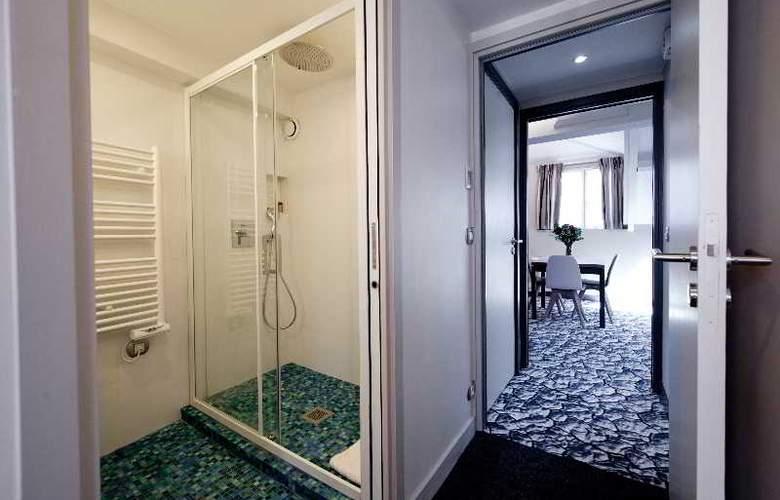 Serotel Suites Hotel - Room - 4