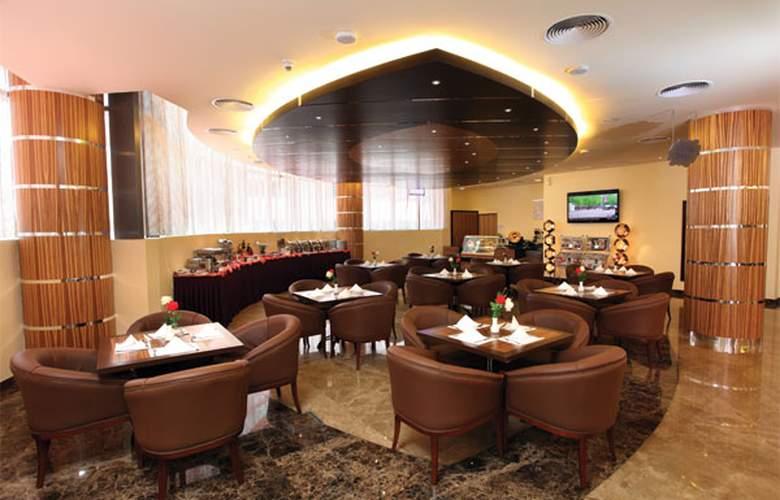 Xclusive Maples Hotel Apartments - Restaurant - 4