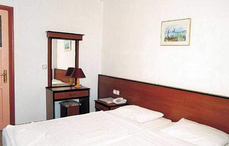 Volkan Hotel - Room - 4