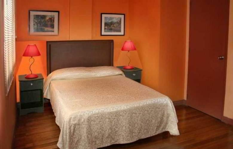 1775 Adriatico Suites - Room - 9