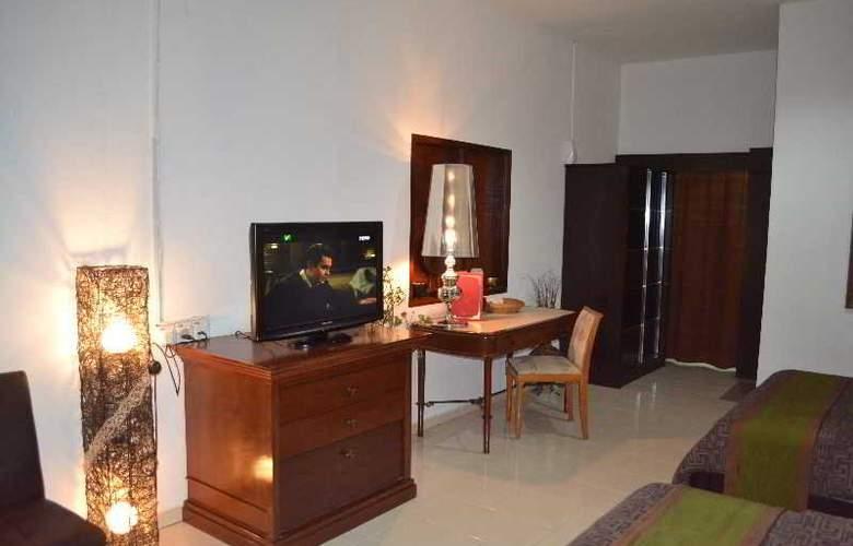 Rasa Eksotika Vacation Home - Room - 16