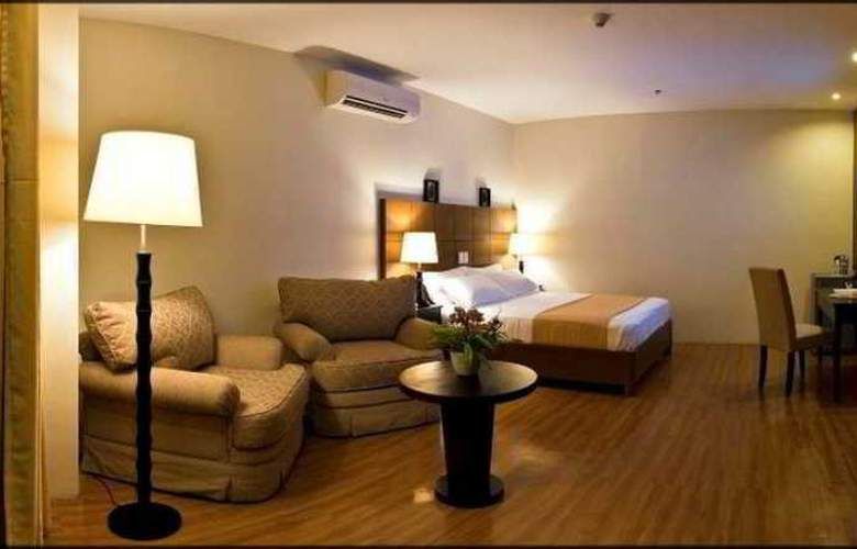 The Pinnacle Hotel and Suites - Room - 6
