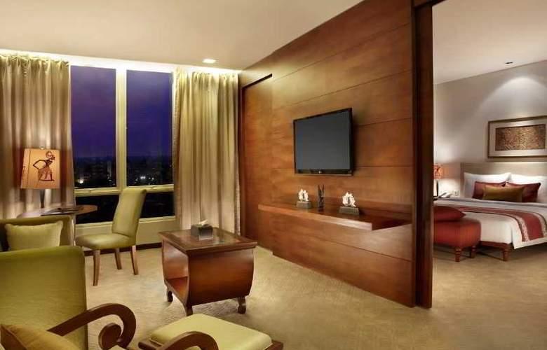 Jambuluwuk Malioboro Boutique Hotel - Room - 11