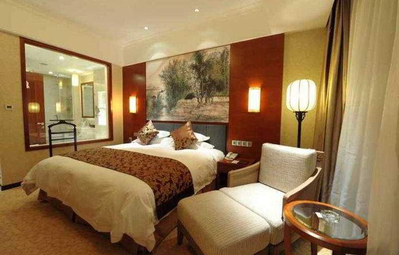Gucun Park Hotel - Room - 0