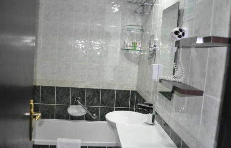 Al Jawhara Hotel Apartments - Room - 10