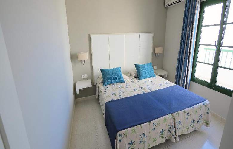 Cay Beach Sun - Room - 9