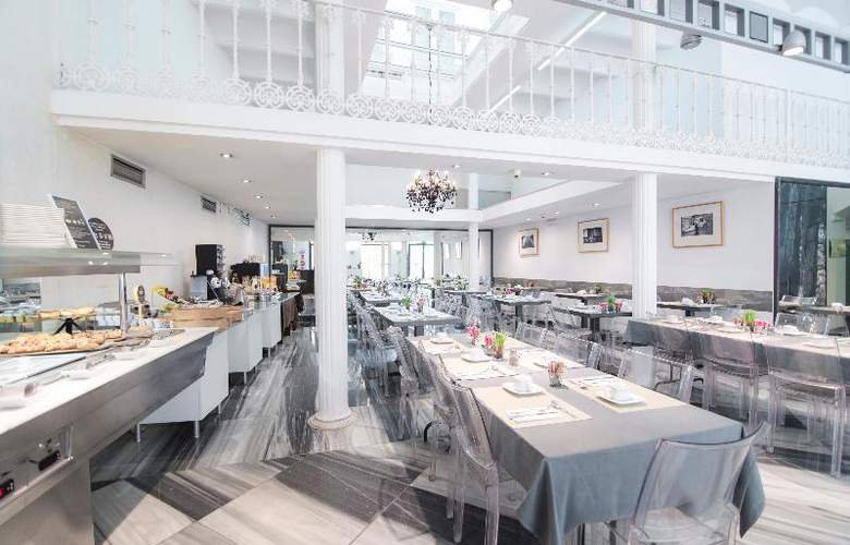 Petit Palace Plaza de la Reina - Restaurant - 17