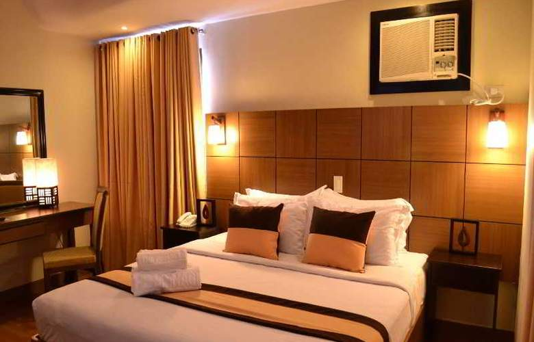 The Pinnacle Hotel and Suites - Room - 8