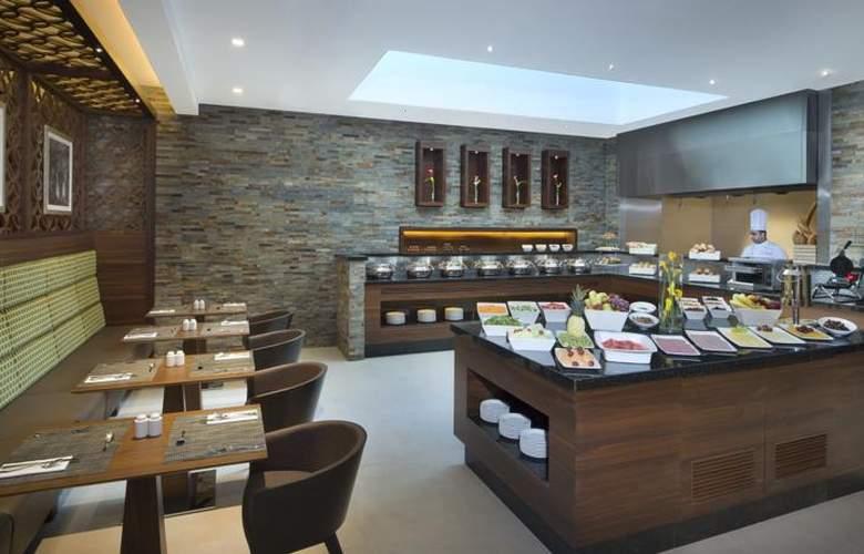 Hilton Garden Inn Dubai Al Muraqabat Hotel - Restaurant - 6