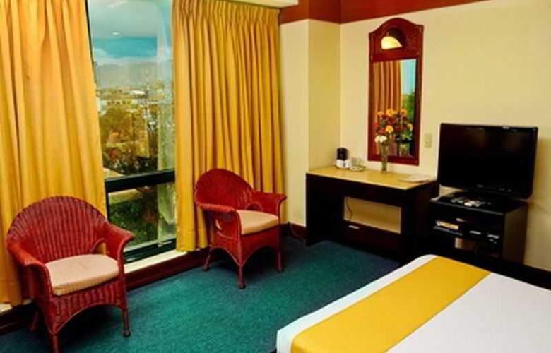 Paragon Suites - Room - 11