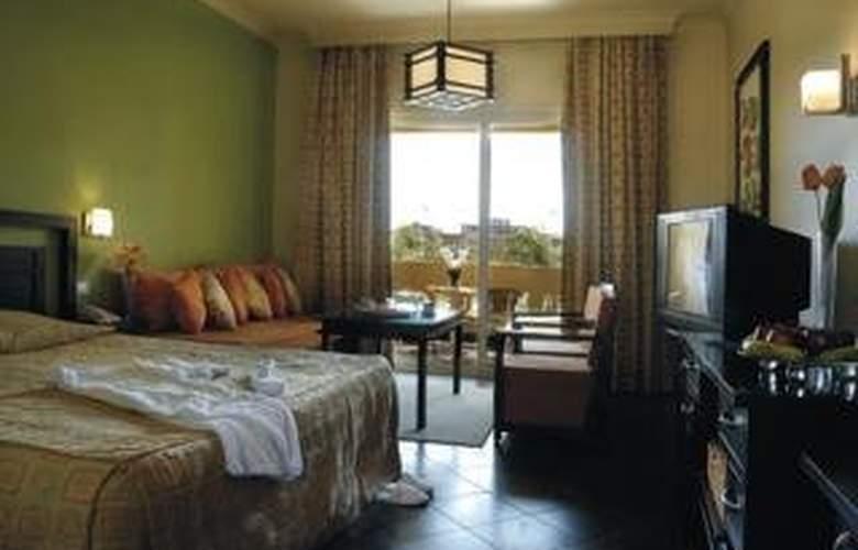 Grand Plaza Hotel - Room - 2