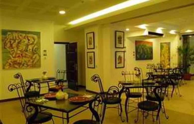 Artina Suites - Restaurant - 3