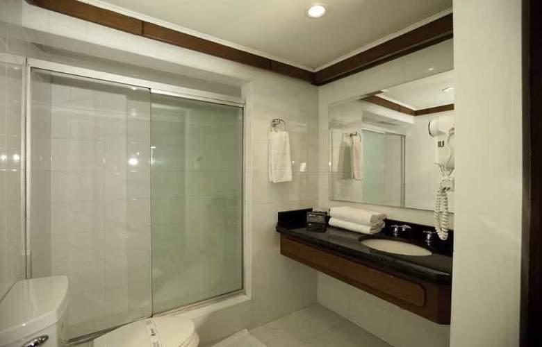 Travelers Apartamentos y Suites CondominioPlenitud - Room - 11