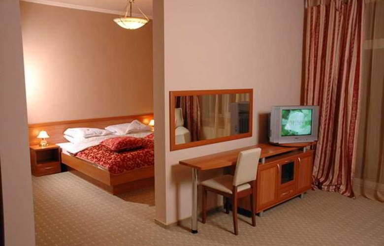 Uzlissya Hotel - Room - 4
