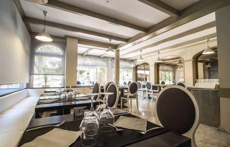 Apartamentos Turísticos Royal Life - Restaurant - 26