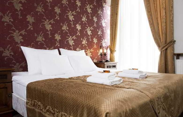 Abella Suites & Apartments - Room - 12