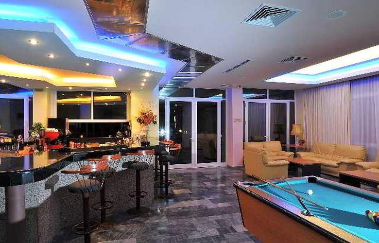 Tylissos Beach Hotel - Bar - 6