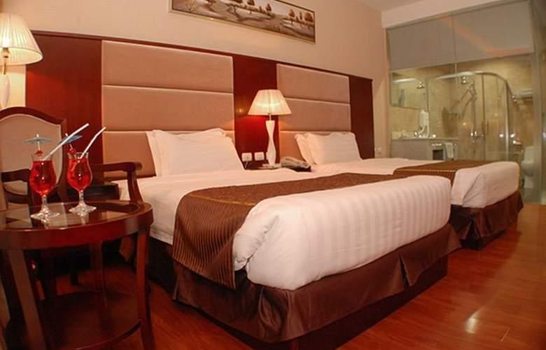 Sunlight Guest Hotel - Room - 8