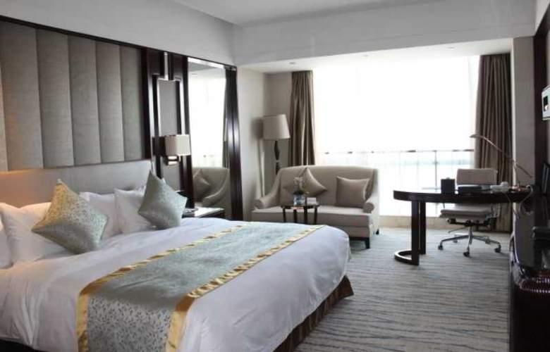 Howard Johnson Kangda Plaza Qingdao - Room - 7