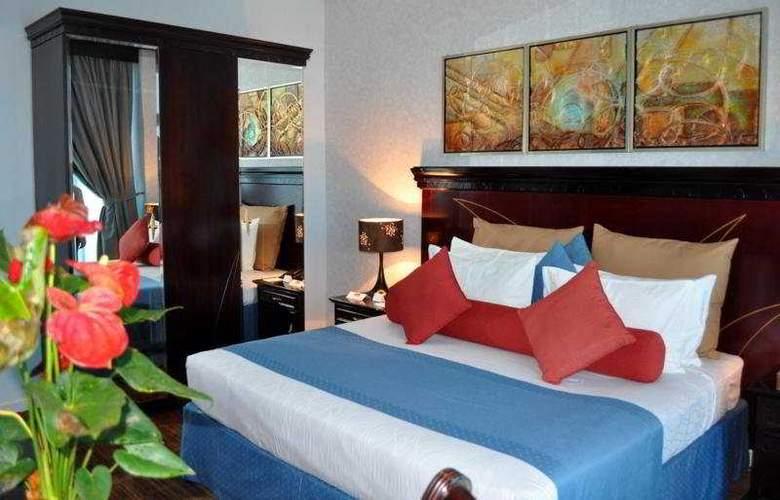 Al Jawhara Hotel Apartments - Room - 4