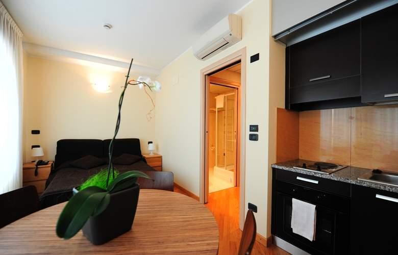 Residence Corvetto Porto di Mare - Room - 9
