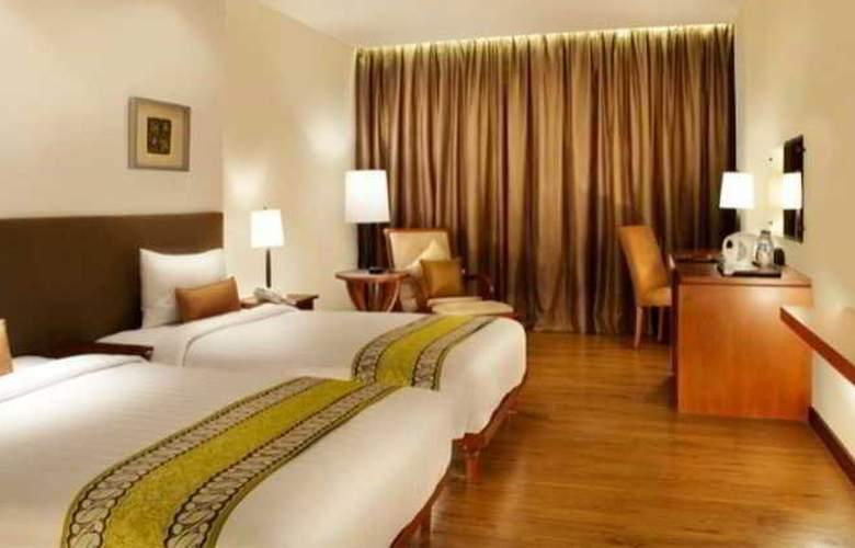 Jambuluwuk Malioboro Boutique Hotel - Room - 9