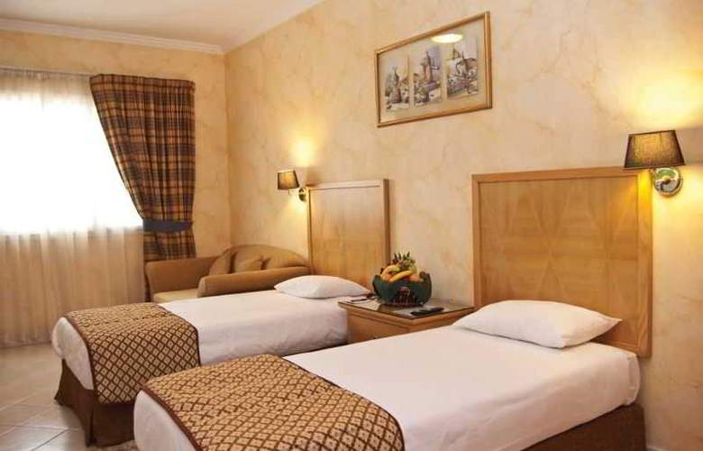 Ramee Hotel Apartment Dubai - Room - 8