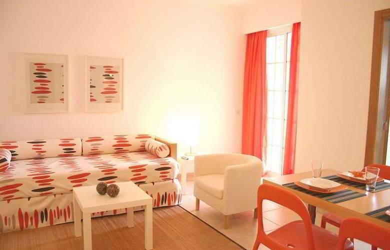 Aquamar Apartamentos - Room - 1
