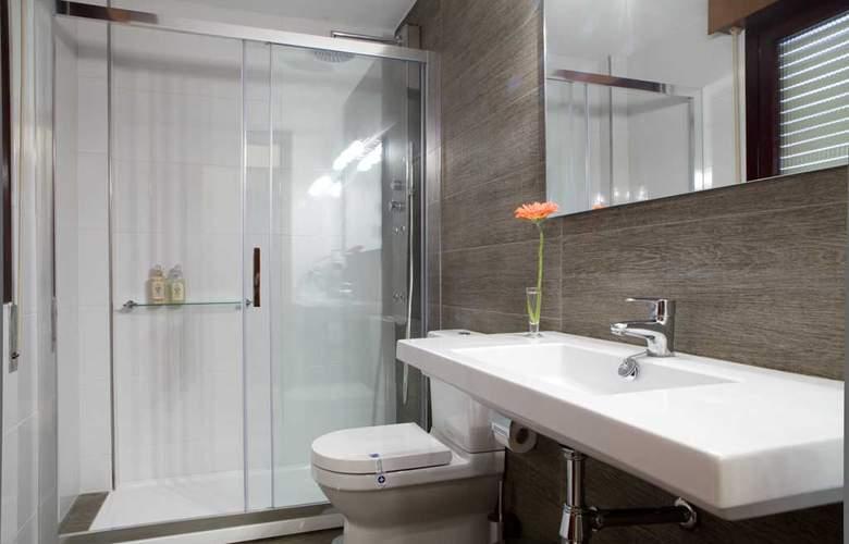 Los Arces Apartamentos - Room - 11