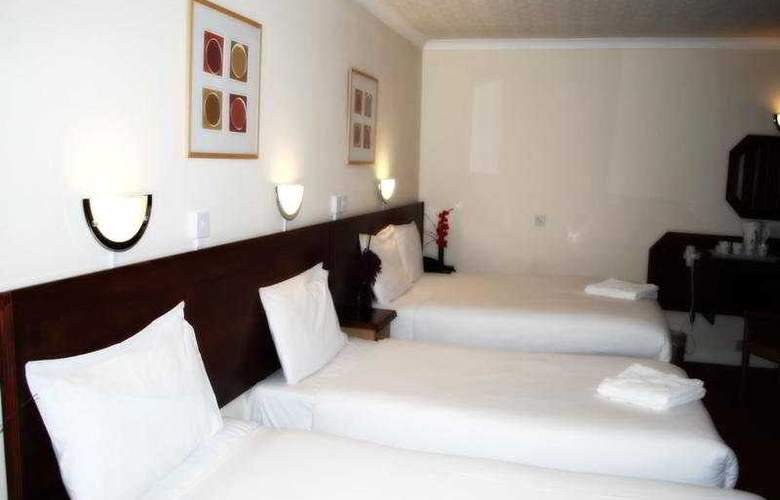 Skyplaza Hotel - Room - 3