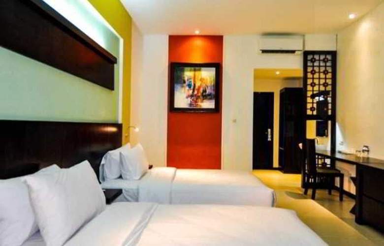 Odua Ozz Hotel Kuta - Room - 4