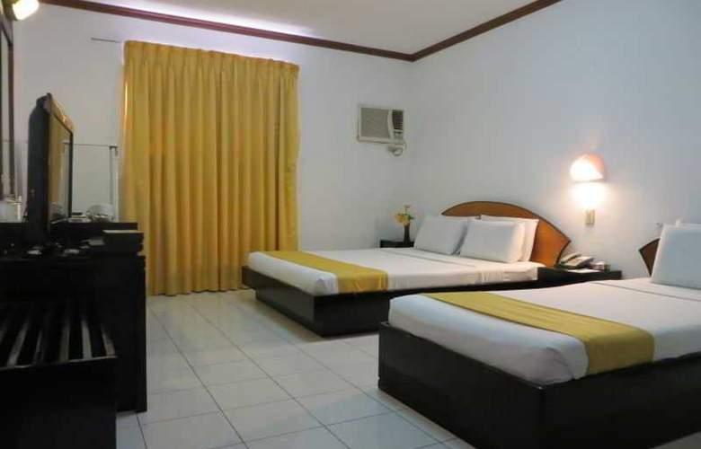 Paragon Suites - Room - 16