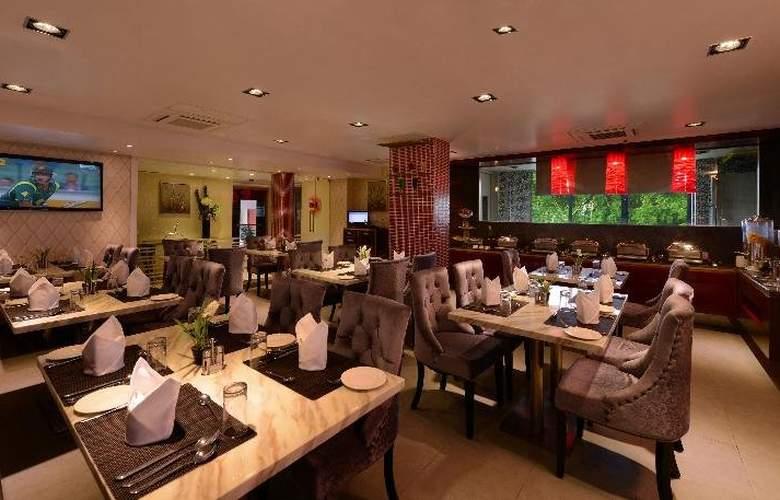 Tulip Inn Ahemadbad - Restaurant - 4
