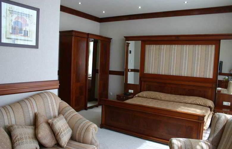 Sun Rise Hotel - Room - 11