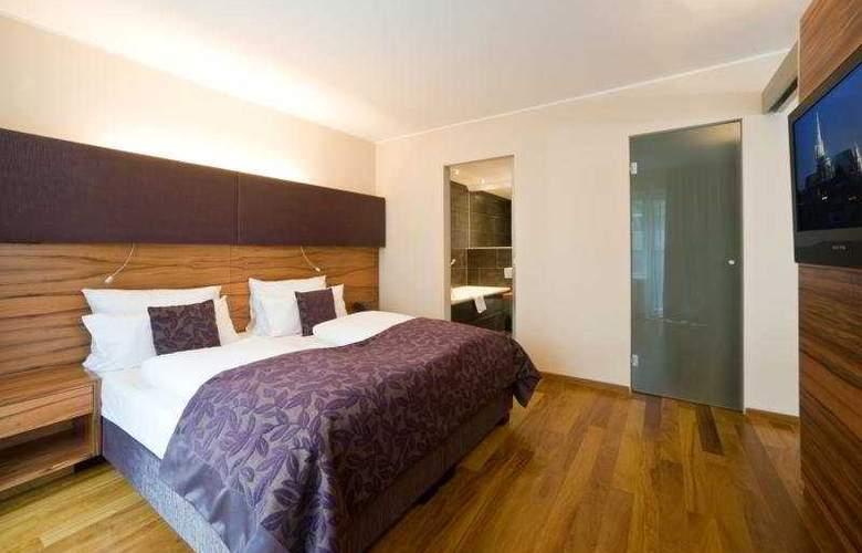 Pakat Suites Hotel - Room - 4