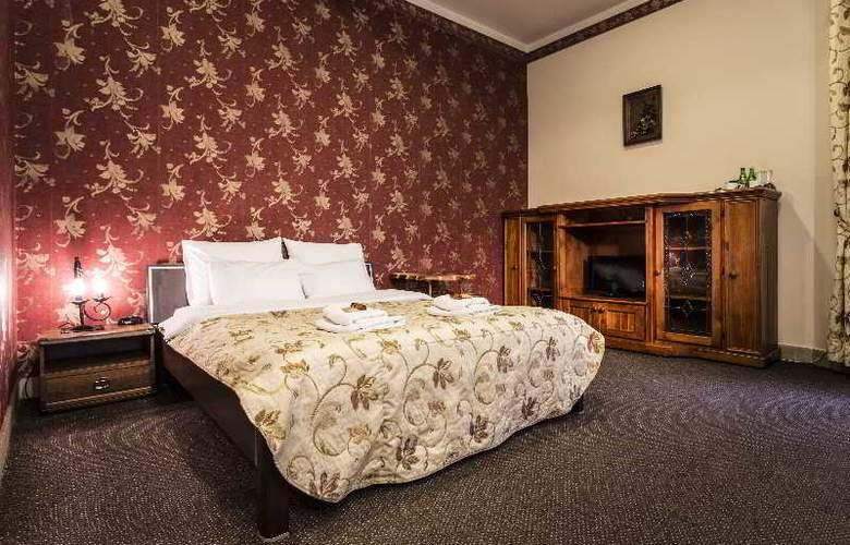 Abella Suites & Apartments - Room - 2