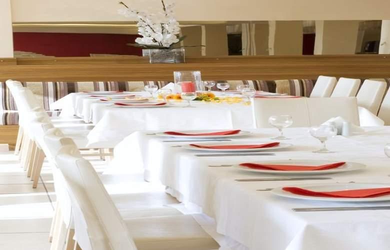 Ariti Grand Hotel - Restaurant - 5