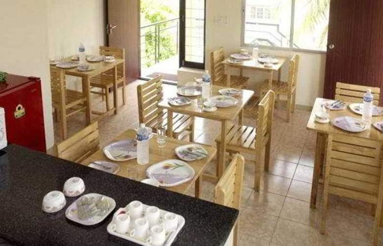 Chalet Orchid Service Apartment - Restaurant - 8