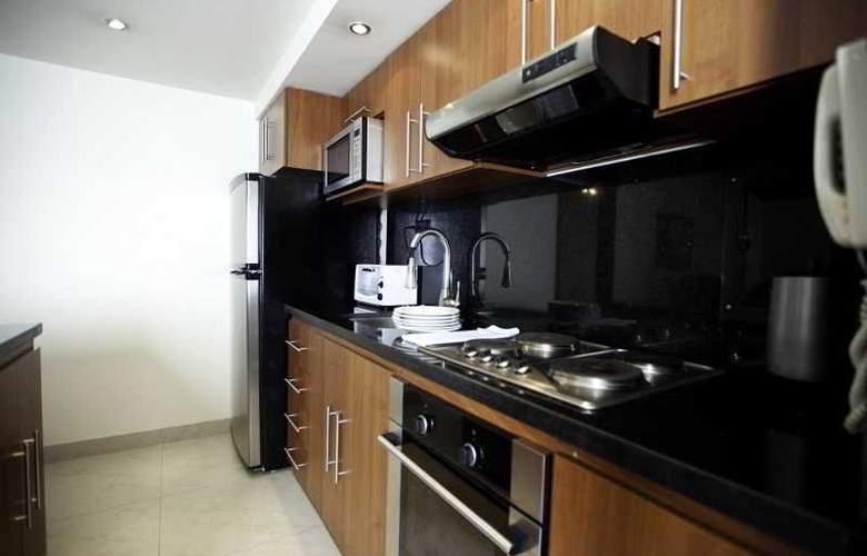 Travelers Apartamentos y Suites CondominioPlenitud - Room - 8