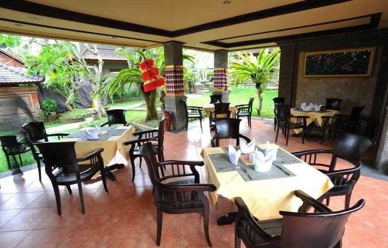 De Munut Cottages - Restaurant - 9