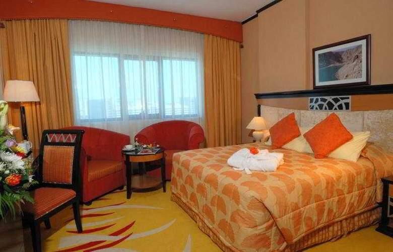 Al Jawhara Gardens - Room - 1