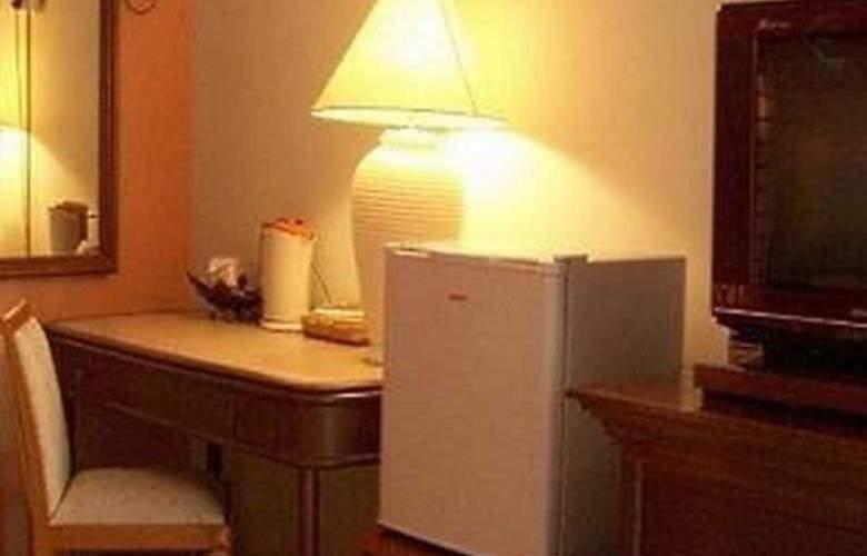 Rasa Eksotika Vacation Home - Room - 15