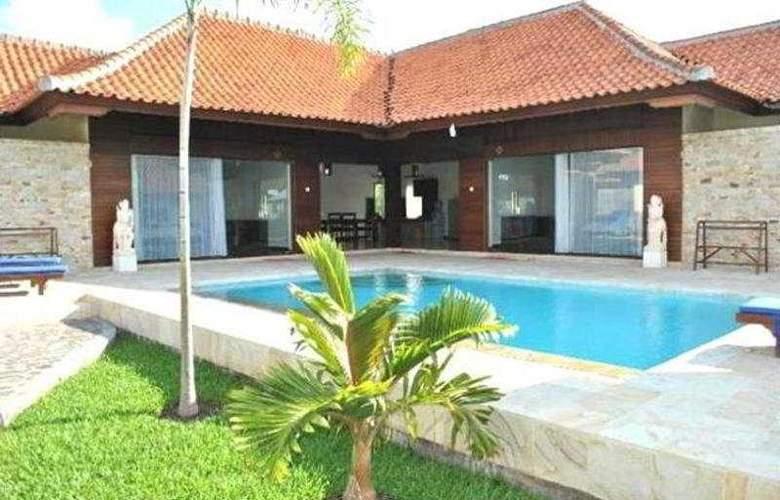 Adi Assri Beach Cottages Singaraja - Pool - 2