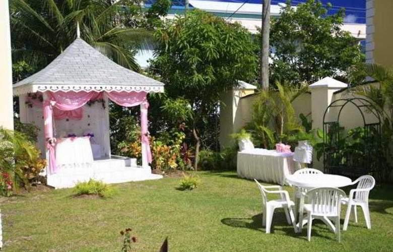 Bay Gardens Inn - Hotel - 8